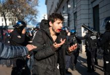 FRANCE – ARTHUR NACIRI POLICE ASSAULT DURING RETIREMENT REFORM DEMONSTRATION IN LYON