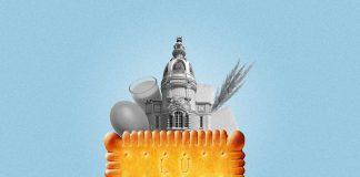 Une composition présentant un biscuit Petit beurre au premier plan. Derrière, on aperçoit la tour LU de Nantes, ainsi que les ingrédients qui entrent dans la composition du biscuit (blé, beurre, oeuf et sucre)
